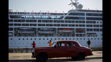 FILE - This May 2, 2016, file photo, shows the Adonia cruise ship arriving in Havana, Cuba, from Miami. Cruise ship operator Carnival is citing the U.S. ban on cruises to Cuba among factors that will cause its full-year earnings to fall short of expectations. The Miami company's second quarter profit fell 20%, although the results were better than Wall Street expected. (AP Photo/Desmond Boylan, File)