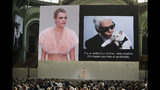 "Model Cara Delevingne is seen on a giant screen as she speaks to the invited guests during the event named ""Karl for Ever"" at the Grand Palais in Paris, France, Thursday, June 20, 2019. The event pays tribute to late German fashion designer Karl Lagerfeld who died Feb. 19, 2019. (AP Photo/Francois Mori)"