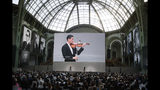 "Violinist Charlie Siem performs on stage during the event named ""Karl for Ever"" at the Grand Palais in Paris, France, Thursday, June 20, 2019. The event pays tribute to late German fashion designer Karl Lagerfeld who died Feb. 19, 2019. (AP Photo/Francois Mori)"