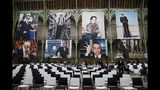 "Photographes of late German fashion designer Karl Lagerfeld are displayed for an event named ""Karl for Ever"" at the Grand Palais in Paris, France, Thursday, June 20, 2019. The event pays tribute to late German fashion designer Karl Lagerfeld who died Feb. 19, 2019. (AP Photo/Francois Mori)"