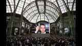 "Photographes of late German fashion designer Karl Lagerfeld are displayed during the event named ""Karl for Ever"" at the Grand Palais in Paris, France, Thursday, June 20, 2019. The event pays tribute to late German fashion designer Karl Lagerfeld who died Feb. 19, 2019. (AP Photo/Francois Mori)"