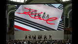 "Dancers perform on stage during the event named ""Karl for Ever"" at the Grand Palais in Paris, France, Thursday, June 20, 2019. The event pays tribute to late German fashion designer Karl Lagerfeld who died Feb. 19, 2019. (AP Photo/Francois Mori)"