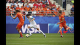 Canada's Christine Sinclair, center, controls the ball between Netherlands' Anouk Dekker, left, and Netherlands' Dominique Bloodworth during the Women's World Cup Group E soccer match between the Netherlands and Canada at Stade Auguste-Delaune in Reims, France, Thursday, June 20, 2019. (AP Photo/Francisco Seco)