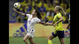 United States' Kelley O Hara looks to kick the ball clear of Sweden's Fridolina Rolfo, right, during the Women's World Cup Group F soccer match between Sweden and the United States at Stade Océane, in Le Havre, France, Thursday, June 20, 2019. (AP Photo/Alessandra Tarantino)