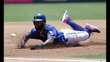 Texas Rangers' Danny Santana steals third ahead of the throw to the bag in the first inning of a baseball game against the Cleveland Indians in Arlington, Texas, Thursday, June 20, 2019. (AP Photo/Tony Gutierrez)