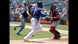 Texas Rangers shortstop Elvis Andrus (1) sprints home scoring on a wild pitch by Cleveland Indians' Shane Bieber, left rear, as catcher Kevin Plawecki moves to cover the plate in the first inning of a baseball game in Arlington, Texas, Thursday, June 20, 2019. (AP Photo/Tony Gutierrez)