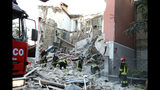 Firefighters search through the rubble of a collapsed building in Gorizia, northeastern Italy, Thursday, June 20, 2019. According to reports, the three-story building is believed to have collapsed following a gas explosion, leaving three people dead. (Pierluigi Bumbaca/ANSA via AP)