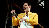 """FILE - In this July 20, 1986 file photo, Queen lead singer Freddie Mercury performs, in Germany. A previously unheard and unreleased song by Mercury was released Thursday, June 20, 2019. Universal Music announced that the track, """"Time Waits for No One,"""" was originally recorded in 1986 for the concept album of the musical """"Time"""" with musician Dave Clark. A video to accompany the song was also released and includes unseen performance footage of Mercury. It was recorded in April 1986 at London's Dominion Theatre. (AP Photo/Marco Arndt, File)"""