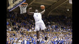FILE - In this Jan. 5, 2019, file photo, Duke's Zion Williamson (1) drives for a dunk against Clemson during the second half of an NCAA college basketball game, in Durham, N.C. Zion Williamson is the most hyped, most exciting prospect to come to the NBA in years. He's set to be the No. 1 pick in the draft, perhaps the only certainty heading into Thursday night, June 20. (AP Photo/Gerry Broome, File)
