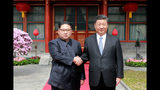 FILE - In this March 27, 2018, file photo, North Korean leader Kim Jong Un, left, shakes hands with Chinese counterpart Xi Jinping at Diaoyutai State Guesthouse in Beijing, China. Kim's fifth meeting with Xi continues his ambitious diplomatic outreach that has included summits with the leaders of the United States, South Korea and Russia in the past year and a half. Experts say Kim is attempting to form a united front with North Korea's main ally China to strengthen his leverage in the stalled nuclear negotiations with the United States. (Korean Central News Agency/Korea News Service via AP, File)