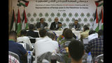 Hamas' chief Ismail Haniyeh, center, speaks during his meeting with foreign reporters at al-Mat'haf hotel in Gaza City, Thursday, June 20, 2019. Hamas' chief says Israel is ignoring the terms of an indirect cease-fire agreement for the Gaza Strip. (AP Photo/Adel Hana)