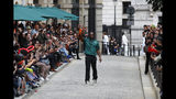Designer Virgil Abloh accepts applause at the conclusion of the Vuitton mens Spring-Summer 2020 fashion collection presented in Paris, Thursday, June 20. (AP Photo/Francois Mori)