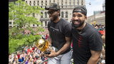 Toronto Raptors' Kawhi Leonard holds his MVP trophy with rapper/producer Drake as they celebrate during the team's NBA basketball championship parade in Toronto, Monday, June 17, 2019. (Frank Gunn/The Canadian Press via AP)