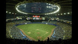 FILE - In this Sept. 29, 2004, file photo, fans watch a baseball game between the Montreal Expos and Florida Marlins at Olympic Stadium in Montreal. The Tampa Bay Rays have received permission from Major League Baseball's executive council to explore a plan that could see the team split its home games between the Tampa Bay area and Montreal, reports said Thursday, June 20, 2019. (Paul Chiasson/The Canadian Press via AP, File)