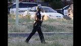 A Sacramento Police officer responds to the shooting of a fellow officer in Sacramento, Calif., Wednesday, June 19, 2019. (AP Photo/Rich Pedroncelli)
