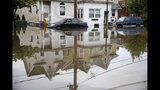 Floodwaters partially submerge vehicles on Broadway in Westville, N.J. Thursday, June 20, 2019. Severe storms containing heavy rains and strong winds spurred flooding across southern New Jersey, disrupting travel and damaging some property. (AP Photo/Matt Rourke)