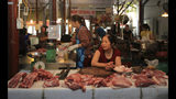 Pork is on display for sale at a market in Hanoi, Vietnam, Thursday, June, 20, 2019. Asian nations are scrambling to contain the spread of the highly contagious African swine fever with Vietnam culling 2.5 million pigs and China reporting more than a million dead in an unprecedentedly huge epidemic governments fear have gone out of control. (AP Photo/Hieu Dinh)