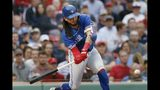 Toronto Blue Jays' Freddy Galvis hits a two-run single during the first inning of a baseball game against the Boston Red Sox in Boston, Friday, June 21, 2019. (AP Photo/Michael Dwyer)