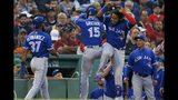 Toronto Blue Jays' Randal Grichuk (15) celebrates his two-run home run that also drove in Teoscar Hernandez (37) during the third inning of a baseball game against the Boston Red Sox in Boston, Friday, June 21, 2019. (AP Photo/Michael Dwyer)