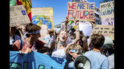People take part in a 'Fridays for Future' protest rally in Aachen, Germany, Friday, June 21, 2019. (Marcel Kusch/dpa via AP)