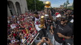 Toronto Raptors' Kawhi Leonard and Kyle Lowry hold up the trophies as they celebrate during the team's NBA basketball championship parade in Toronto, Monday, June 17, 2019. (Frank Gunn/The Canadian Press via AP)