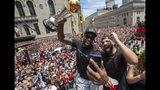 Toronto Raptors' Kawhi Leonard holds his MVP trophy while celebrating with rapper/producer Drake during the team's NBA basketball championship parade in Toronto, Monday, June 17, 2019. (Frank Gunn/The Canadian Press via AP)