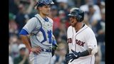 Boston Red Sox's Christian Vazquez, right, celebrates his solo home run in front of Toronto Blue Jays' Luke Maile during the third inning of a baseball game in Boston, Saturday, June 22, 2019. (AP Photo/Michael Dwyer)