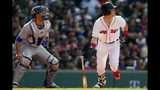 Boston Red Sox's Andrew Benintendi watches his two-run double in front of Toronto Blue Jays' Luke Maile during the second inning of a baseball game in Boston, Saturday, June 22, 2019. (AP Photo/Michael Dwyer)