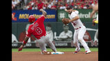 St. Louis Cardinals shortstop Paul DeJong, right, turns a double play over Los Angeles Angels' Justin Upton, left, during the third inning of a baseball game Sunday, June 23, 2019, in St. Louis. Kole Calhoun was out at first. (AP Photo/L.G. Patterson)