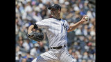 New York Yankees starting pitcher J.A. Happ throws during the first inning of a baseball game against the Houston Astros at Yankee Stadium, Sunday, June 23, 2019, in New York. (AP Photo/Seth Wenig)