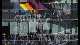 Revelers are reflected in a building's windows during the annual gay pride parade along Paulista avenue in Sao Paulo, Brazil, Sunday, June 23, 2019. (AP Photo/Nelson Antoine)