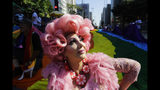 A reveler poses for a picture during the annual gay pride parade along Paulista avenue in Sao Paulo, Brazil, Sunday, June 23, 2019. (AP Photo/Nelson Antoine)