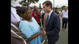 In this Wednesday, June 19, 2019 photo, South Bend Mayor and Democratic presidential candidate Pete Buttigieg shares a moment with Shirley Newbill, mother of Eric Logan, during a gun violence memorial at the Martin Luther King Jr. Recreation Center in South Bend, Ind. (Michael Caterina/South Bend Tribune via AP)