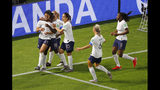 France's Valerie Gauvin, left, celebrates with teammates after scoring her side's first goal during the Women's World Cup round of 16 soccer match between France and Brazil at Stade Oceane, in Le Havre, France, Sunday, June 23, 2019. (AP Photo/Francois Mori)
