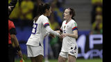 United States' Rose Lavelle, right, is substituted by teammate Christen Press during the Women's World Cup Group F soccer match between Sweden and the United States at Stade Océane, in Le Havre, France, Thursday, June 20, 2019. (AP Photo/Alessandra Tarantino)