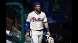Philadelphia Phillies' Bryce Harper walks through the dugout after a baseball game against the Miami Marlins, Sunday, June 23, 2019, in Philadelphia. (AP Photo/Matt Slocum)