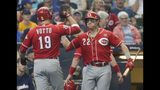 Cincinnati Reds' Joey Votto is congratulated by Derek Dietrich (22) after hitting a three-run home run during the sixth inning of a baseball game against the Milwaukee Brewers Sunday, June 23, 2019, in Milwaukee. (AP Photo/Morry Gash)