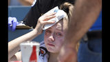A young fan holds ice to her head after being hit with a foul ball hit by Los Angeles Dodgers' Cody Bellinger during the first inning of a baseball game against the Colorado Rockies, Sunday, June 23, 2019, in Los Angeles. (AP Photo/Mark J. Terrill)