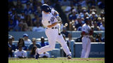 Los Angeles Dodgers' Will Smith hits a two-run walkoff home run during the ninth inning of a baseball game against the Colorado Rockies Sunday, June 23, 2019, in Los Angeles. (AP Photo/Mark J. Terrill)