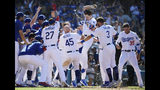 Los Angeles Dodgers' Will Smith, third from right, scores as teammates celebrate after hitting a two-run walkoff home run during the ninth inning of a baseball game against the Colorado Rockies Sunday, June 23, 2019, in Los Angeles. (AP Photo/Mark J. Terrill)