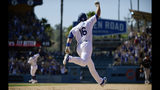 Los Angeles Dodgers' Will Smith (16) celebrates along with Russell Martin, back left, as he rounds first after hitting a two-run walkoff home run during the ninth inning of a baseball game against the Colorado Rockies, Sunday, June 23, 2019, in Los Angeles. (AP Photo/Mark J. Terrill)