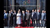 International Olympic Committee (IOC) president Thomas Bach from Germany, center, poses with Sweden's Crown Princess Victoria, center left, and Swedish Prime Minister Stefan Lofven, center right, and members of the candidate for the Olympic Winter Games 2026 Stockholm-Are delegation at the Olympic Museum, in Lausanne, Switzerland, Sunday, June 23, 2019. The host city of the 2026 Olympic Winter Games will be decided in Lausanne on Monday. (Laurent Gillieron/Keystone via AP))