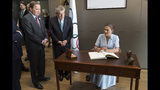 Sweden's Crown Princess Victoria, right, signs the guest book as International Olympic Committee (IOC) president Thomas Bach from Germany, center, and Swedish Prime Minister Stefan Lofven look on in Lausanne, Switzerland, Sunday, June 23, 2019. The host city of the 2026 Olympic Winter Games will be decided in Lausanne on Monday. (Laurent Gillieron/Keystone via AP))
