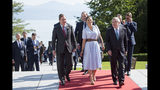 International Olympic Committee IOC president Thomas Bach from Germany, right, arrives with Sweden's Crown Princess Victoria, center, and Swedish Prime Minister Stefan Lofven, in Lausanne, Switzerland, Sunday, June 23, 2019. The host city of the 2026 Olympic Winter Games will be decided in Lausanne on Monday. (Laurent Gillieron/Keystone via AP))