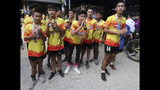 Members of the Wild Boars soccer team who were rescued from a flooded cave, pose for the media after a marathon and biking event in Mae Sai, Chiang Rai province, Thailand, Sunday, June 23, 2019. Some of the 12 young Thai soccer players and their coach have marked the anniversary of their ordeal that saw them trapped in a flooded cave for two weeks with a commemorative marathon in northern Thailand. (AP Photo/Sakchai Lalit)