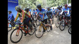 Participants start during a marathon and biking event in Mae Sai, Chiang Rai province, Thailand, Sunday, June 23, 2019. Around 4,000 took part in the event Sunday morning, organized by local authorities to raise funds to improve conditions at the now famous Tham Luang cave complex. The youngsters went in to explore before rain-fed floodwaters pushed them deep inside the dark complex. Their rescue was hailed as nothing short of a miracle. (AP Photo/Sakchai Lalit)