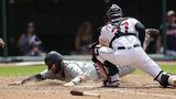 Detroit Tigers' Bobby Wilson, left, slides safely into home plate to score as Cleveland Indians catcher Kevin Plawecki is late on the tag in the eighth inning in a baseball game, Sunday, June 23, 2019, in Cleveland. (AP Photo/Tony Dejak)