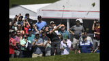 Keegan Bradley hits his second shot on the first hole the final round of the Travelers Championship golf tournament, Sunday, June 23, 2019, in Cromwell, Conn. (AP Photo/Jessica Hill)