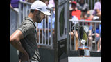 Kevin Tway looks at the the championship trophy on a pedestal at the first tee before starting his final round of the Travelers Championship golf tournament, Sunday, June 23, 2019, in Cromwell, Conn. (AP Photo/Jessica Hill)