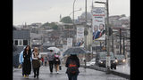 FILE-In this Tuesday, May 7, 2019 file photo, people walk on Galata Bridge over the Golden Horn in Istanbul, decorated with electoral posters of Turkey's President Recep Tayyip Erdogan and his party's Istanbul mayoral candidate Binali Yildirim, following the announcement by Turkey's top electoral body that annulled the results of the March 31 vote. Voters in Istanbul return to the polls on Sunday, June 23, 2019 for a rerun of the election for the mayor of the city. (AP Photo/Lefteris Pitarakis, File)
